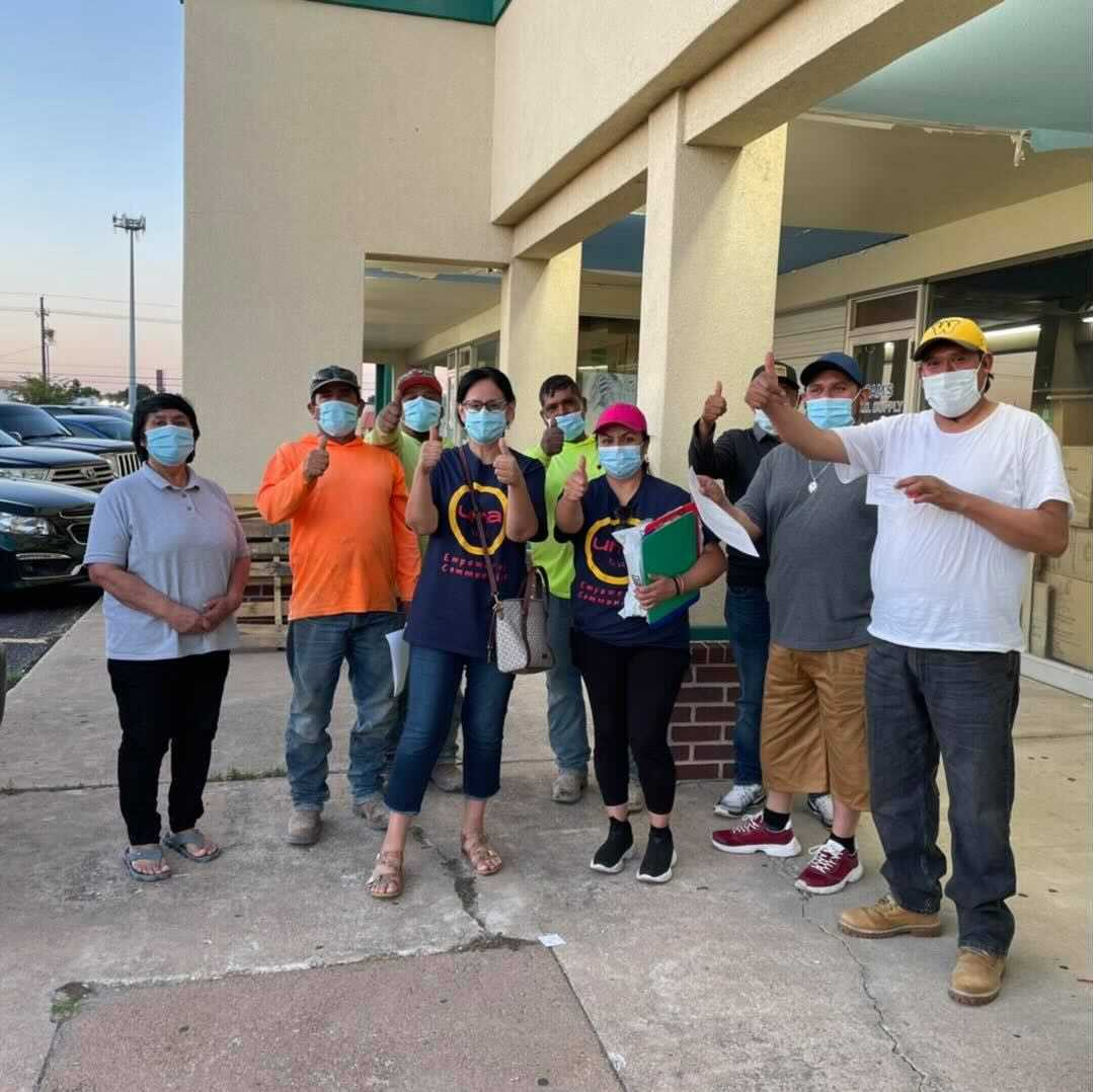 Image of people wearing masks and holding up a thumbs up